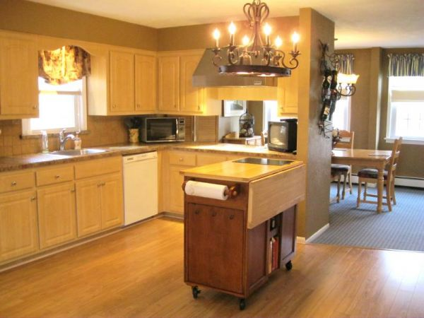 Eat-in-kitchen Updated with ample cabinets, butcher block center island included